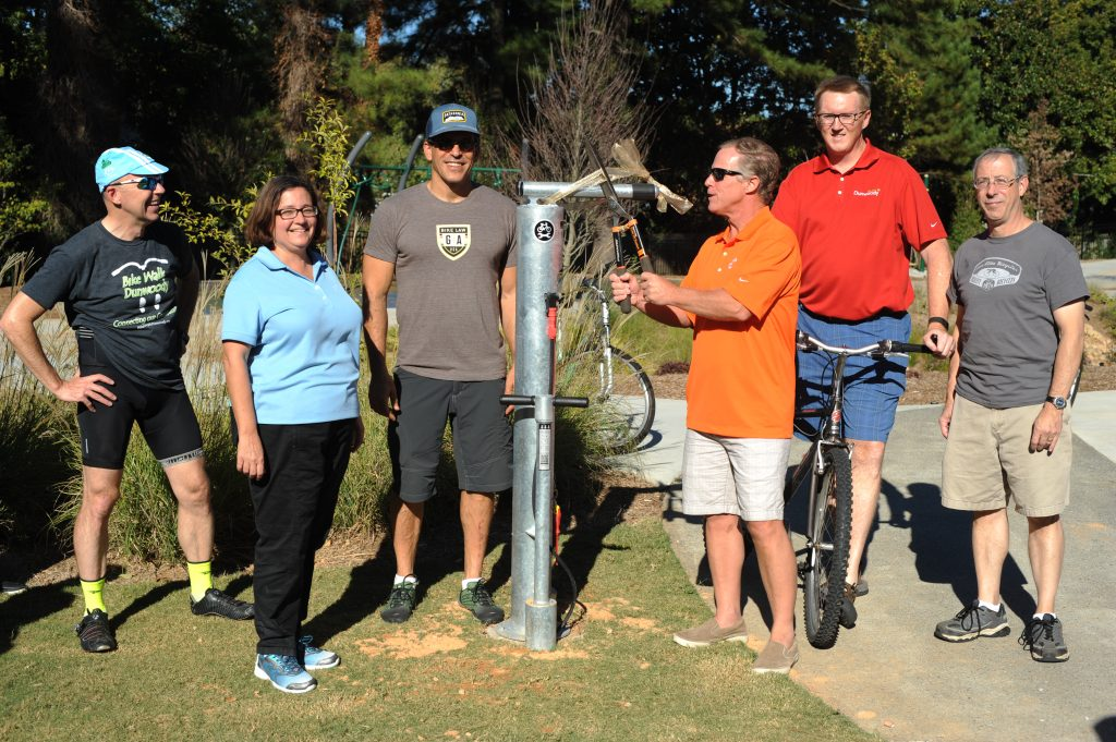 ribbon-cutting-ceremony-of-a-public-bike-repair-station-on-the-trail